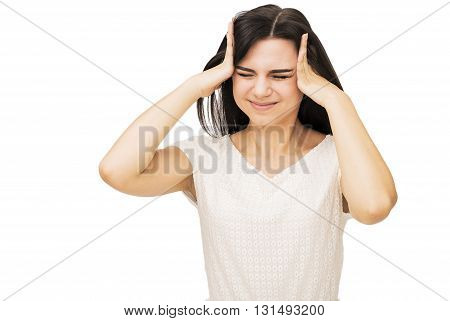 portrait of young woman suffering from headache