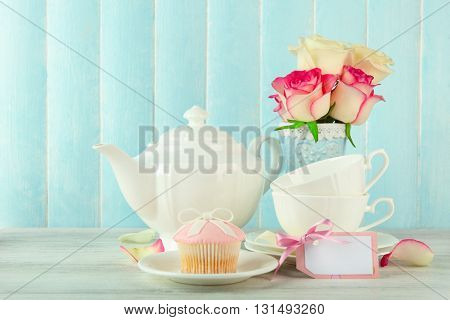 Happy Mother's day concept. Roses in a vase and empty card.