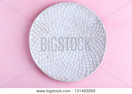 Empty plate on pink background