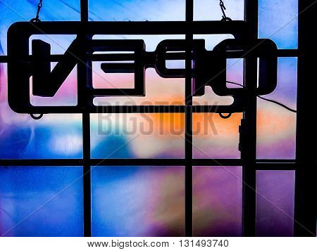 open neon sign with colorful window background