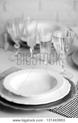 Table set at restaurant on light background