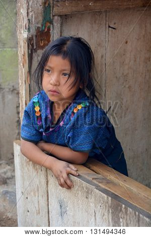 SANTA CATARINA PALOPO DE ATITLAN GUATEMALA NAY 01 2016: Portrait of a Mayan child in blue huipil. The Mayan people still make up a majority of the population in Guatemala,