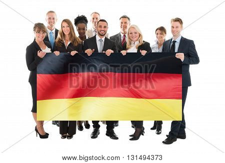 Businesspeople Holding German Flag Against White Background