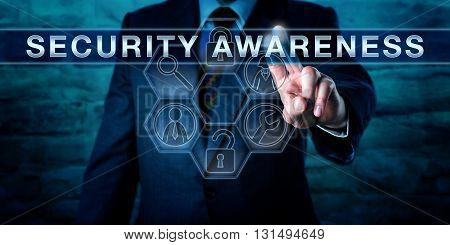 Industry consultant is pressing SECURITY AWARENESS on an interactive touch screen interface. Information technology concept for both computer or cyber security and physical asset protection.
