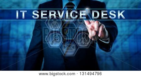 Torso of corporate client is pushing IT SERVICE DESK on a virtual touch screen display. Business metaphor and information technology concept for professional support in the service industry.