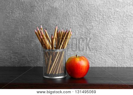 Composition with pencils on wooden table