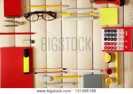 Flat lay of stationery on wooden background, copy space