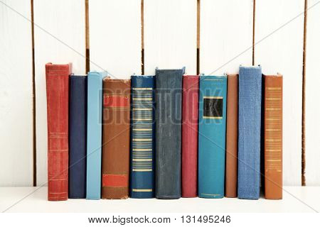 Book collection on wooden background