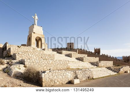Lookout above Almeria with statue of Jesus and remains of ancient city wall
