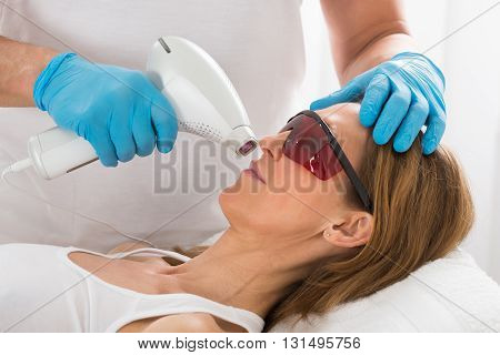 Mature Woman Receive Laser Epilation In Beauty Clinic