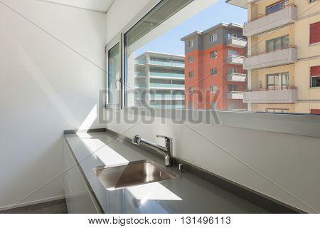 empty apartment, sink of modern kitchen, interior