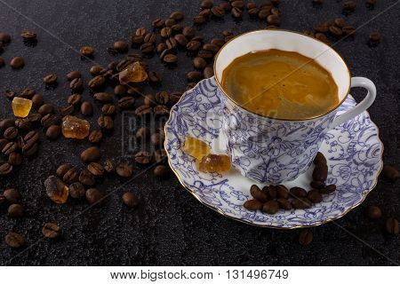 Coffee grains and china cup of coffee. Coffee cup. Strong coffee. Coffee mug. Morning coffee. Cup of coffee. Coffee break.
