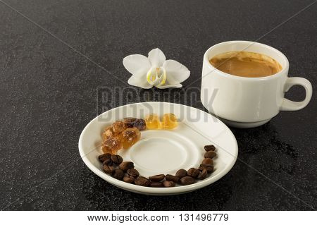 Coffee grains cup of coffee and orchid. Coffee cup. Strong coffee. Coffee mug. Morning coffee. Cup of coffee. Coffee break.