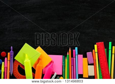 Colourful stationery on black background