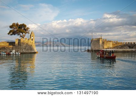 Amazing sunset of the port of Nafpaktos town, Western Greece