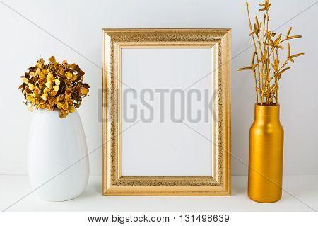 Frame mockup with golden vase. Frame mockup. Poster Mockup. Styled mockup. Product mockup. Design Mockup. Gold frame mockup. White frame mockup.