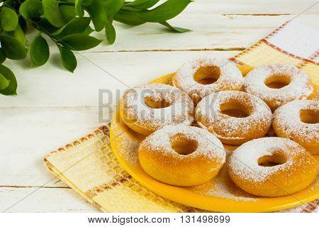 Hanukkah donuts on yellow plate. Sweet dessert. Sweet pastry. Doughnuts. Donuts. Hanukkah donuts