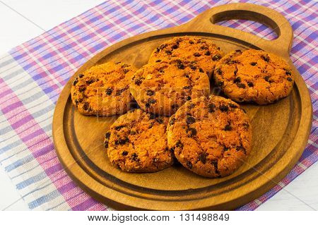 Homemade cookies on the cutting board. Breakfast cookies. Tea cup. Homemade cookies. Tea time. Sweet dessert. Homemade biscuit.
