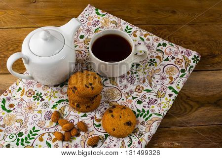 Breakfast tea teapot and cookies. Homemade biscuit. Homemade cookies.Sweet dessert. Breakfast cookies. Sweet pastry. Cup of tea. Tea cup. Breakfast tea.
