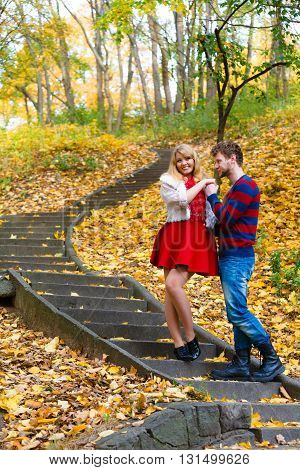 Romantic Pair Meet In Park Standing On Stairs.