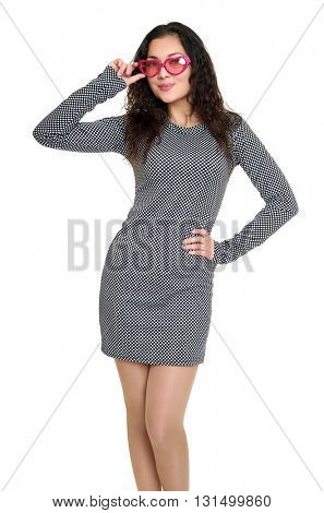 young woman beautiful portrait in black and white checkered dress, pink sunglasses in shape of heart, long curly hair, glamour concept, isolated on white background