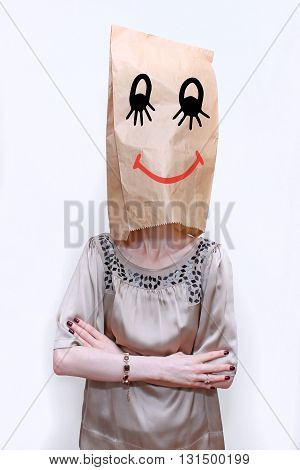 Woman with paper bag over her head with smiley face drawing