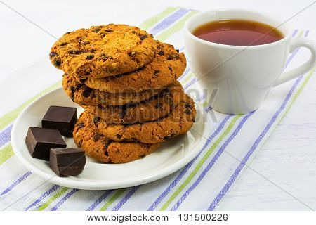 Homemade cookies and cup of tea. Sweet dessert. Homemade biscuit. Breakfast cookies. Tea cup. Tea time. Homemade cookies.