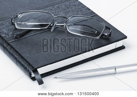 Organizer glasses and pen toned. Business background