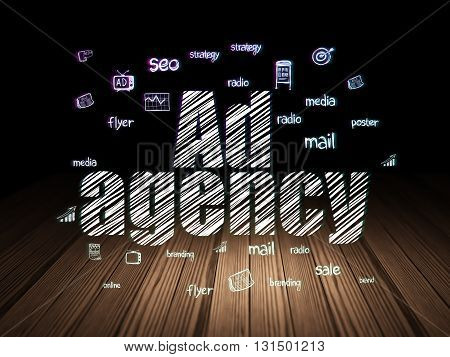 Marketing concept: Glowing text Ad Agency,  Hand Drawn Marketing Icons in grunge dark room with Wooden Floor, black background