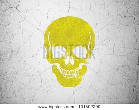 Medicine concept: Yellow Scull on textured concrete wall background