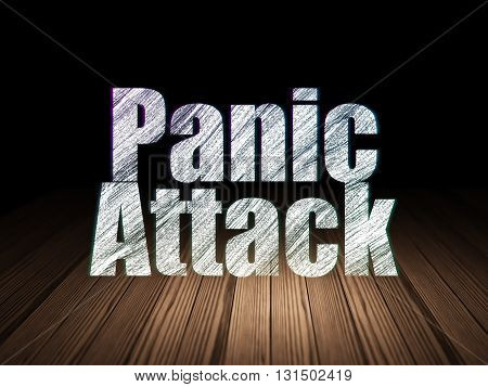 Healthcare concept: Glowing text Panic Attack in grunge dark room with Wooden Floor, black background