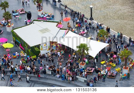 LONDON, UK - SEPTEMBER 19, 2016: Busy cafe at the River Thames embankment with lots of people