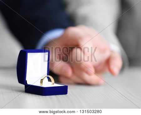 Couple of homosexuals and wedding ring on a table
