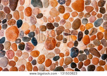 Pebble texture. Wall round stone rock texture and seamless background.