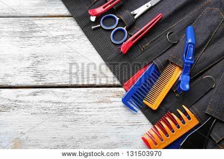 Professional hairdressing equipment in black case on white wooden table background