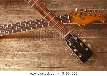 Two guitars on wooden background