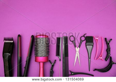 Hairdresser set with various accessories on violet background