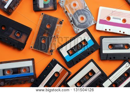 Set of old audio cassettes on red background