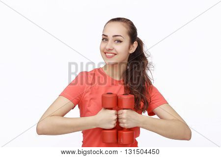Portrait of smiling fitness young woman doing exercises with dumbbell