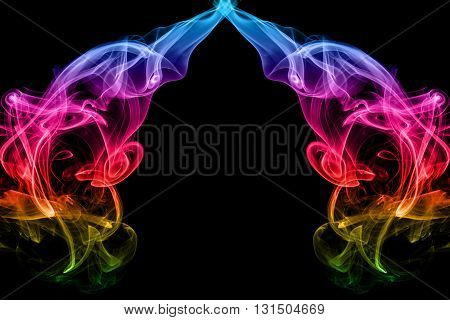 abstract frame from movement of rainbow smoke on black background for graphic design