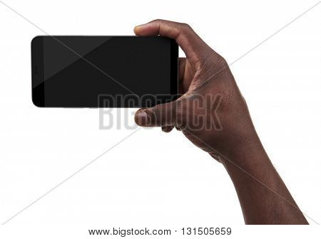 Male hand holding a smartphone isolated on white