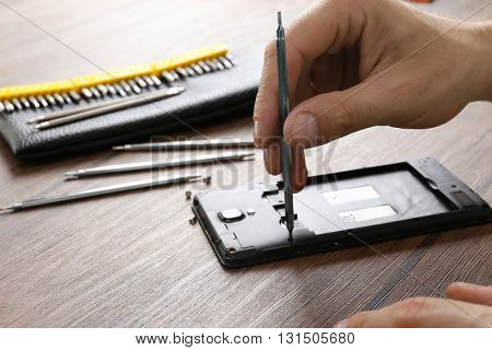 Mobile phone repair, closeup