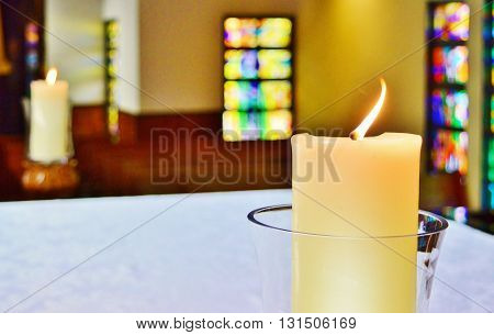 Candles in a church during a religious ceremony