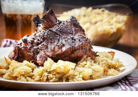 Pork Knuckle With Fried Sauerkraut And Baked Potatoes