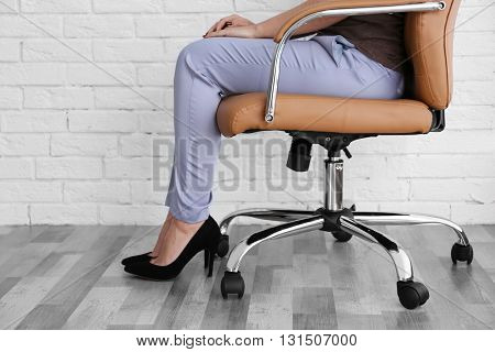 Woman sitting on the office chair indoors