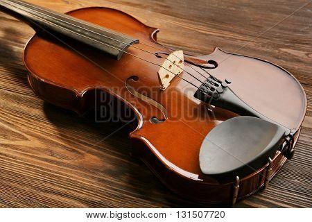 Violin on wooden background