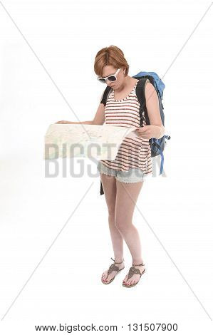 young attractive American tourist woman with red hair holding city map carrying backpacker rucksack and wearing shorts isolated on white background in travel and vacation concept