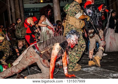 Bologna, Italy - May 21, 2016: Bologna zombie apocalypse walk, a group of people dressed as zombies and scary expressions during a parade through the center of the city.
