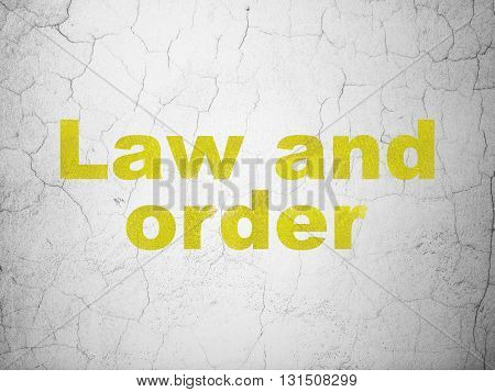 Law concept: Yellow Law And Order on textured concrete wall background