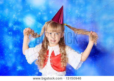 Christmas girl in festive costume over stellar sky.